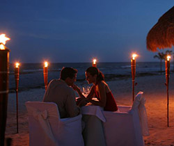 Couple dining on beach